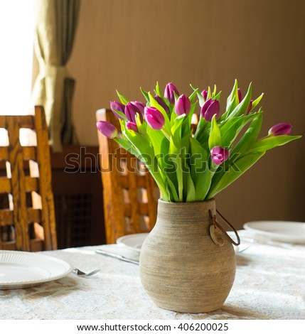 Bunch of tulips in a vase on the table