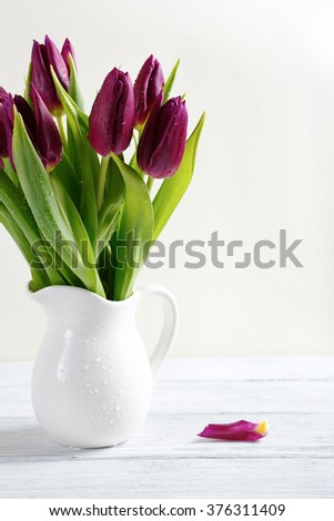 Bunch of tulips in a white vase, tulips - stock photo