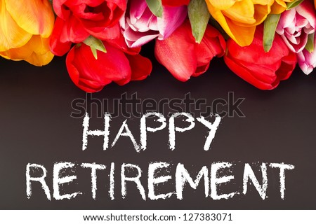 Bunch of tulips with blackboard: happy retirement - stock photo