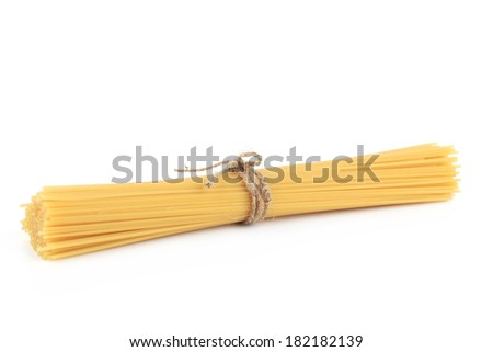 Bunch of uncooked spaghetti. Isolated on a white background. - stock photo