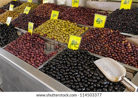 Bunch of various olives at market stall