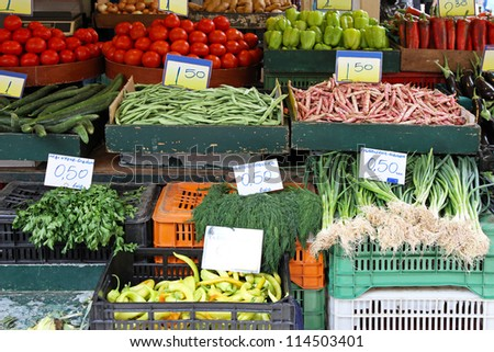 Bunch of vegetables in crates at farmers market - stock photo
