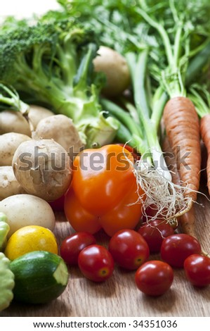 Bunch of whole assorted fresh organic vegetables - stock photo