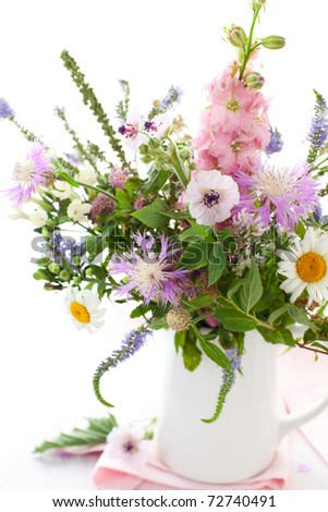 Bunch of wild herbs and flowers in a  jug - stock photo