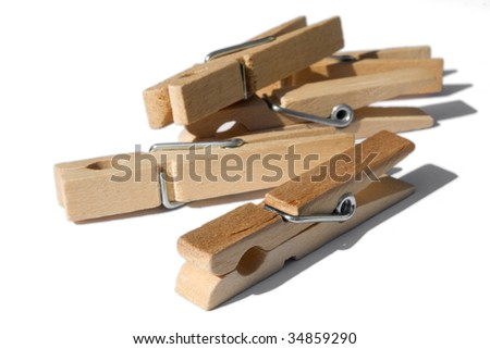 bunch of wooden clothespins isolated on white - stock photo