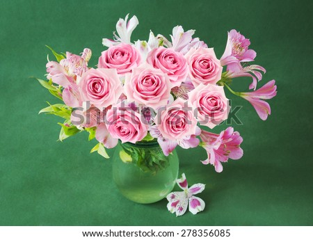 Bunch with roses in vase - stock photo
