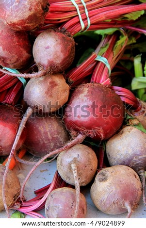 Bunches of beets set together on table at local farmers market