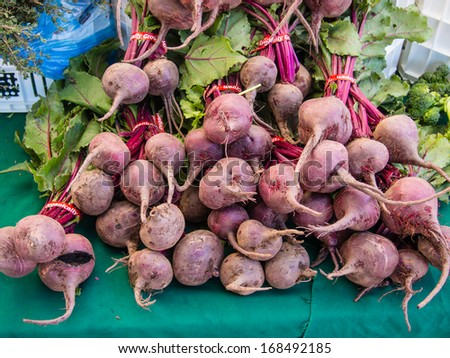 Bunches of fresh organic beetroots for sale at local farmers market.