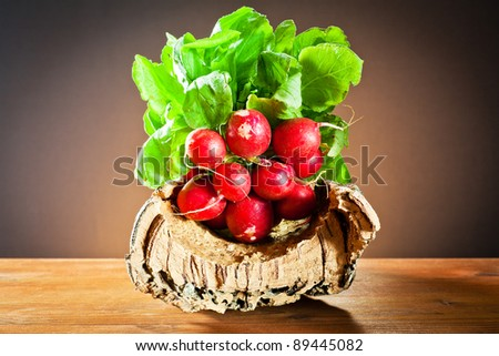 bunches of radishes on tree bark