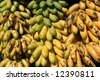 Bunches of yellow and green bananas outside a greengrocer shop. Honduras - stock photo