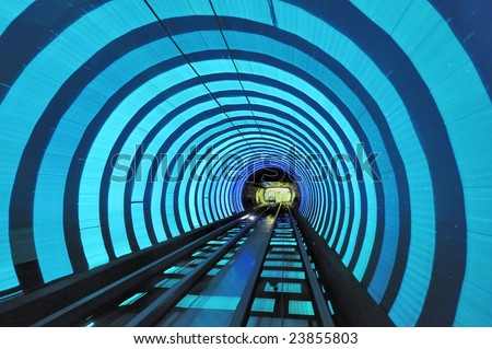 Bund Tourist Tunnel Shanghai is a sightseeing tunnel under the Huangpu river. The tunnel stretches over an area of 646.7 meter, it is the first cross-river artificial sightseeing tunnel of China. - stock photo