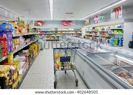 BUNDE, GERMANY - AUGUST 11, 2015: Interior with shopping cart of a ALDI supermarket. Aldi is a leading global discount supermarket chain Based in Germany. Photo taken in Bunde, Germany