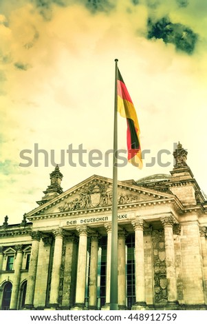 Bundestag in Berlin with the national flag of Germany. Vintage view. Old retro style.  - stock photo