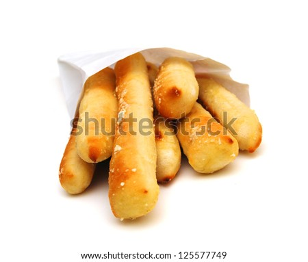 Bundle of bread sticks, home-baked in bag - stock photo