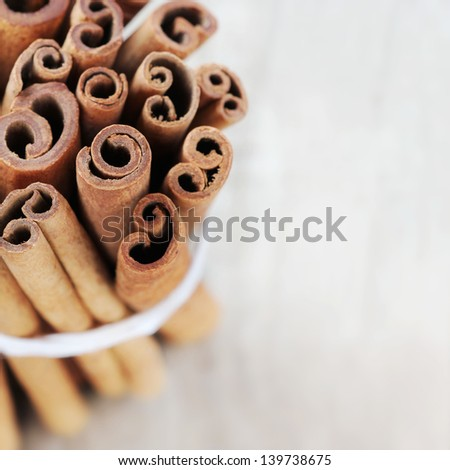 Bundle of cinnamon sticks or quills with copy space - stock photo