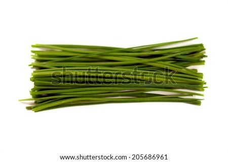 Bundle of fresh green chives on white background. - stock photo
