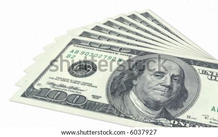 Bundle of hundred dollar banknotes on white background. - stock photo