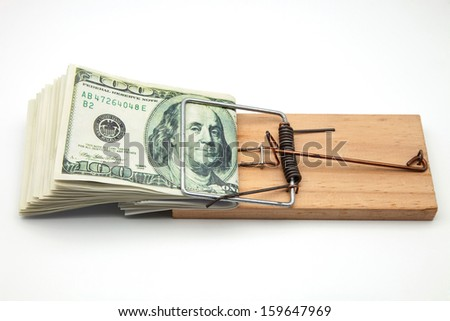 bundle of tickets caught in a mousetrap - stock photo