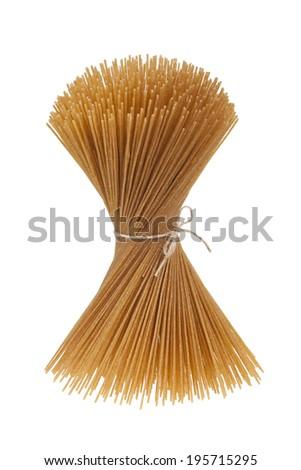 Bundle of uncooked wholegrain spaghetti isolated on white background - stock photo