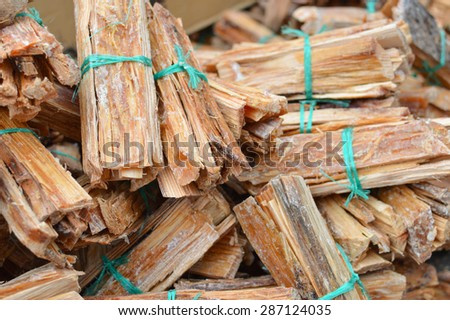 Bundle of wooden planks, tied with rope, for sale at the traditional market in totonicapan, western highlands of Guatemala. Most of the Maya people in here use the firewood to cook food. - stock photo