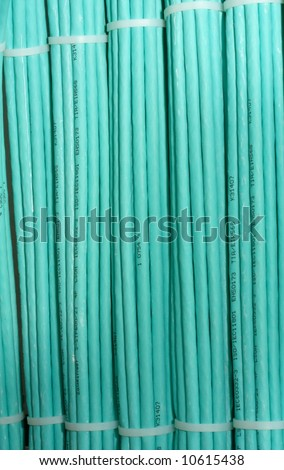 bundled green network cables - stock photo