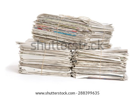 Bundles of newspapers on a white background
