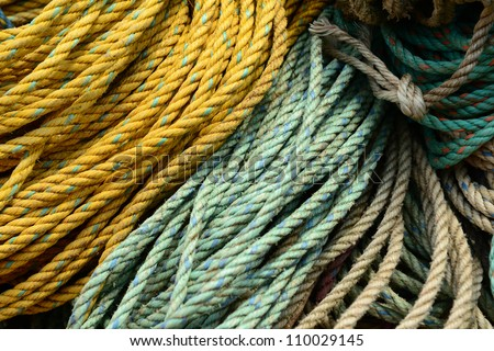 bundles of rope for lobster traps stacked for boarding onto a lobster boat - stock photo