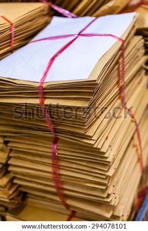 Bundling paper envelopes. - stock photo