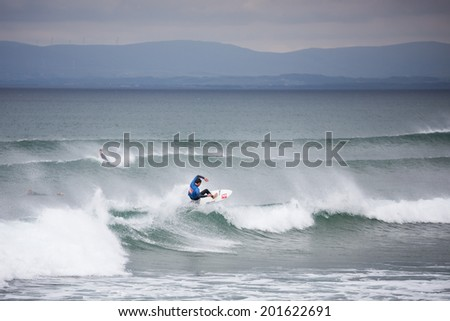 BUNDORAN, IRELAND - JUNE 27: Geroid McDaid performs during Expression Session, part of annual Sea Sessions Surf & Music Festival, on June 27, 2014 in Bundoran, Ireland. - stock photo