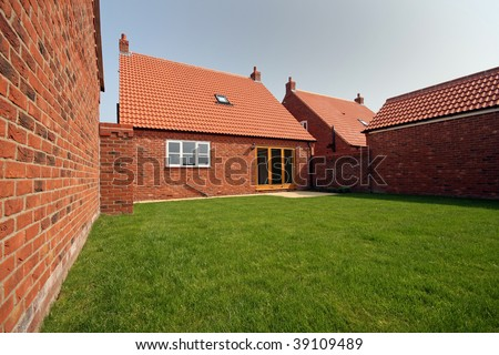 Bungalow garden in early summer in UK - stock photo