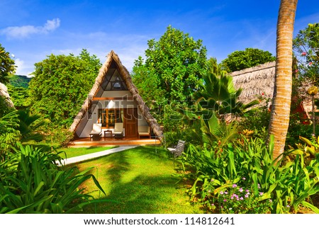 Bungalow in hotel at tropical beach - vacation background - stock photo