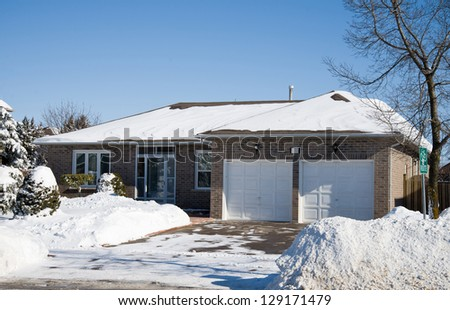 Bungalow in winter - stock photo