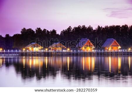 Bungalow near pond : Asia style - stock photo