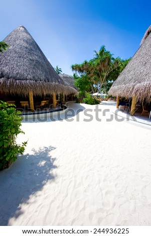 Bungalow on the coral beach. Concept of romantic holidays - stock photo