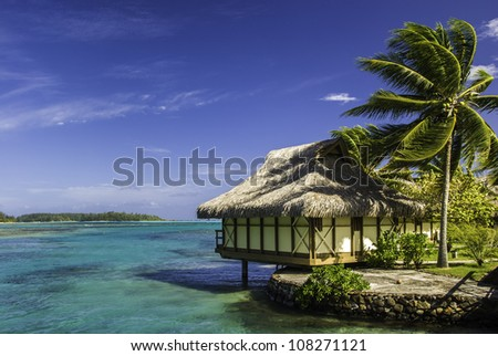 Bungalow on tropical island of Moorea - stock photo