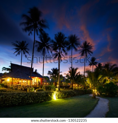 Bungalows at sunset in thailand paradise - stock photo