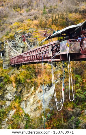 Bungee jumping-Kawarau Bridge near Queenstown. Commercial Bungy Jumping was born here in 1988 and every year tens of thousands make the 43 meter jump. - stock photo