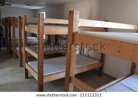Bunk beds in a camp - stock photo