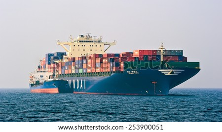Bunkering tanker Ostrov Russkiy container ship Hyundai company. Nakhodka Bay. East (Japan) Sea. 19.04.2014 - stock photo