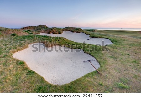 Bunkers on the Castle Course, St Andrews, at sunrise. - stock photo