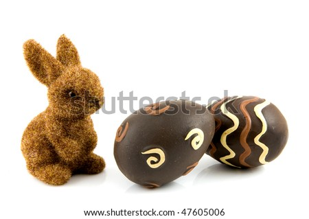 Bunny with easter eggs isolated on white background - stock photo