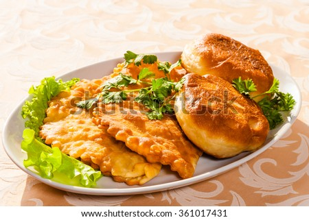 buns fried in oil - stock photo