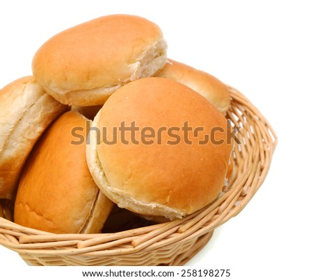buns in basket isolated on white  - stock photo