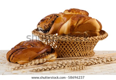 Buns with cinnamon and wheat ears. Isolated. White background.