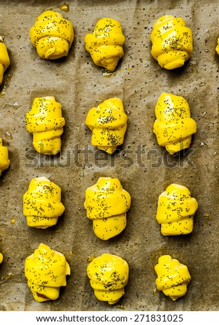 Buns with fillings of delight arranged on a tray before baking - stock photo