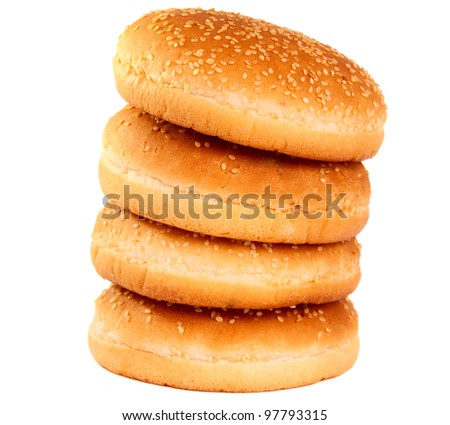 buns with sesame seeds on a white background - stock photo