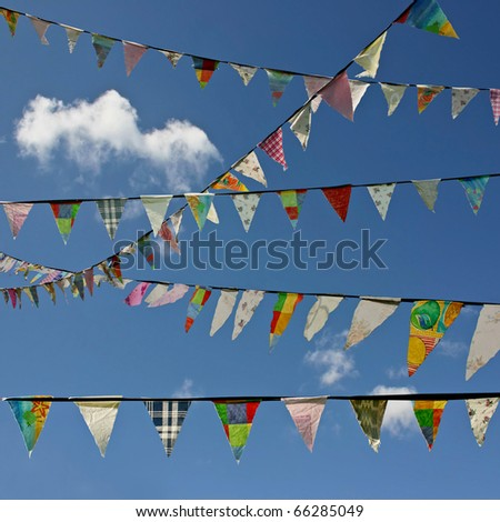 Bunting Flags Blowing in the Wind Against A Blue Sky - stock photo