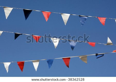 Bunting flags hanging on Broadstairs seafront, Kent, England - stock photo