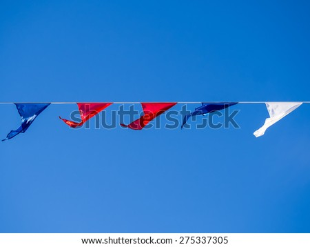 Bunting flags on the sky background - stock photo