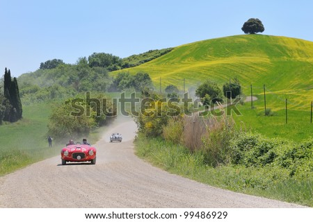 BUONCONVENTO (SIENA). ITALY - MAY 14:  A red 1951 built FERRARI 212 Export driven by Bernhard Sieber during a time trial at 1000 Miglia race on May 14, 2011 near Buonconvento (Siena) - stock photo